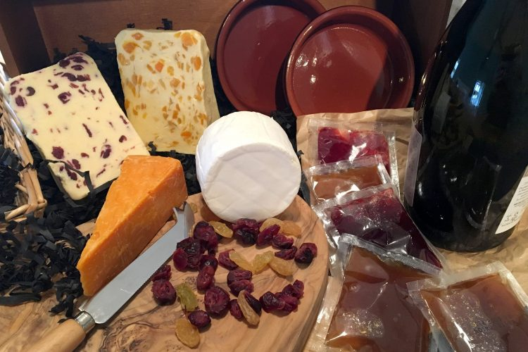 Items used in Contract Packing: Blended Cheeses, Cheese Boards with Knives, Dried Fruit, Sachets of Glaze, Baking Dishes and Packaging Filler